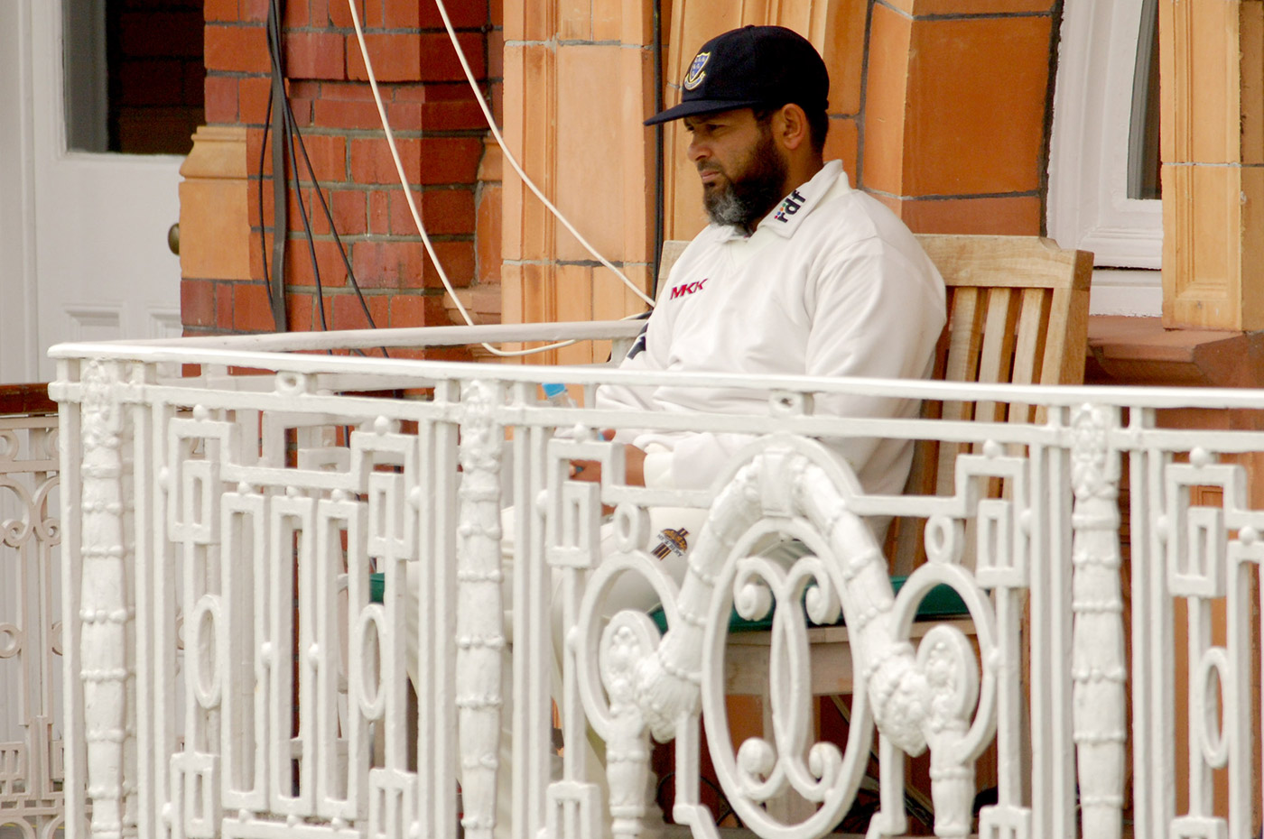 In his office away from home: Mushtaq surveys the scene from the balcony at Lord's