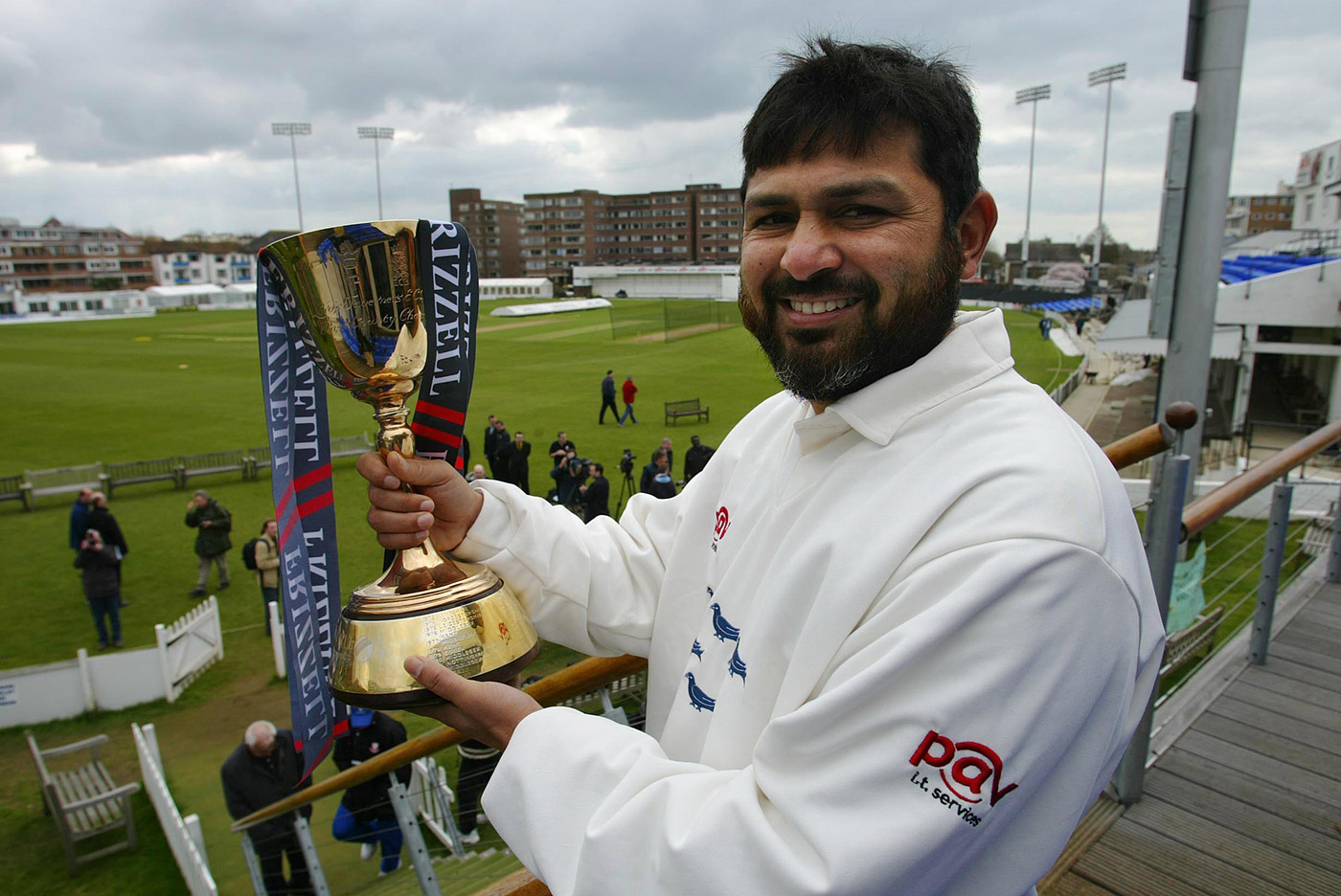 Mushtaq Ahmed shows off the trophy