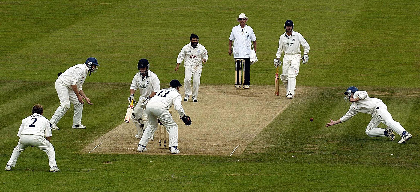 Richard Montgomerie dives for a catch off Mushtaq against Kent in 2004