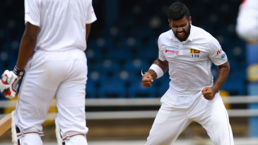 Lahiru Kumara pumps his fists after dismissing Kieran Powell