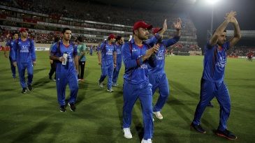 Asghar Stanikzai and Rashid Khan lead the Afghanistan lap of honour