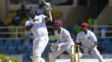 Angelo Mathews plays a one-handed shot
