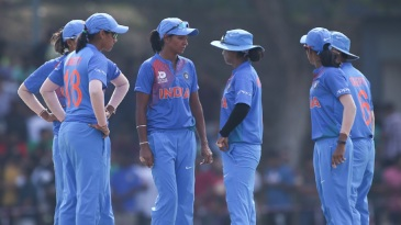 Harmanpreet Kaur has a chat with her team-mates