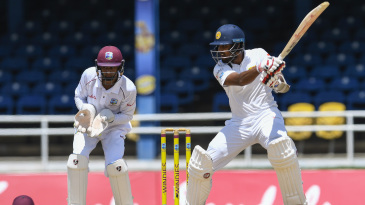 Dinesh Chandimal cuts the ball off the back foot