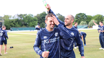Captain Kyle Coetzer gives Calum MacLeod a well deserved victory shower