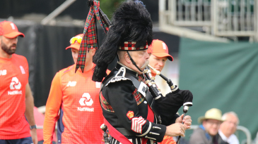 A bagpiper gets the day's soundtrack underway leading the teams out for the anthems