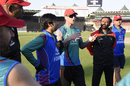 Fielding coach John Mooney talks to the Afghanistan team