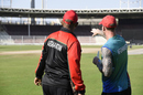 Afghanistan fielding coach John Mooney (right) at a training session