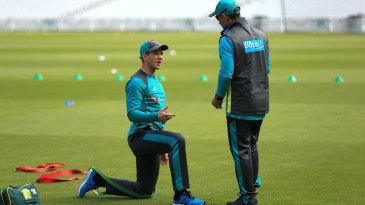 Tim Paine and Justin Langer talk during Australia training