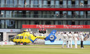 Play was interrupted when an Air Ambulance helicopter had to land on the outfield, Lancashire v Essex, County Championship, Division One, Old Trafford, June 11, 2018