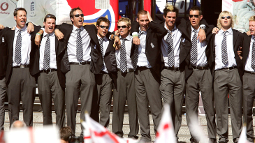 The England team celebrates with crowds in Trafalgar Square