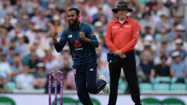 Adil Rashid celebrates the wicket of Marcus Stoinis