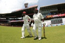 Mohammad Shahzad and Javed Ahmadi walk out to open the Afghanistan innings. India v Afghanistan, Only Test, Bengaluru, 2nd day, June 15, 2018
