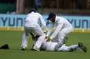 Karun Nair and M Vijay congratulate a prone Ishant Sharma after a catch. India v Afghanistan, Only Test, Bengaluru, 2nd day, June 15, 2018