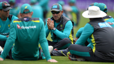 Justin Langer talks to his players at practice