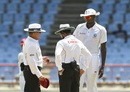 Umpires Ian Gould, Aleem Dar and Jason Holder examine the ball, West Indies v Sri Lanka, 2nd Test, St Lucia, 4th day, June 17, 2018