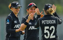 Amelia Kerr celebrates with her team-mates