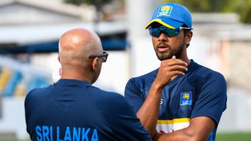 Dinesh Chandimal has a chat with head coach Chandika Hathurusingha