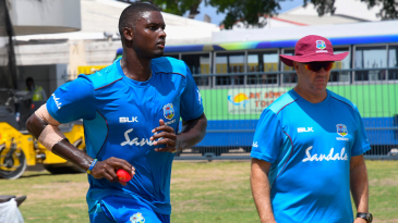 Jason Holder takes part in a training session with Stuart Law by his side