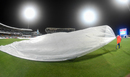 Covers come onto the field at the Kensington Oval, West Indies v Sri Lanka, 3rd Test, Bridgetown, 1st day, June 23, 2018