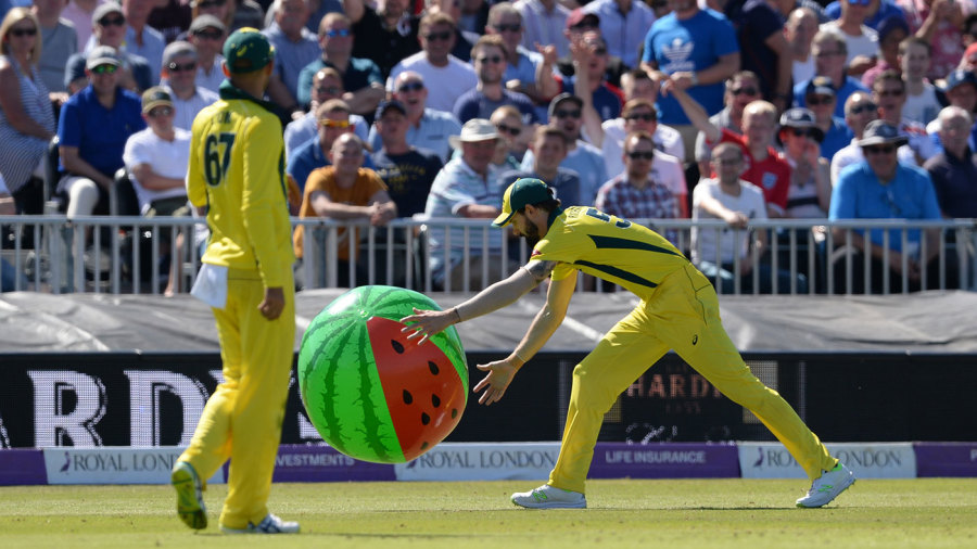 Australia's fielders chase an inflatable melon