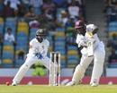 Jason Holder drives through the covers. West Indies v Sri Lanka, 3rd Test, Bridgetown, 2nd day, June 24, 2018