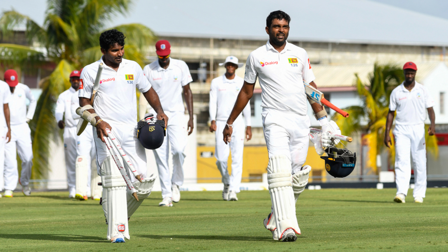 Kusal Perera and Dilruwan Perera troop off the field after steering Sri Lanka to victory