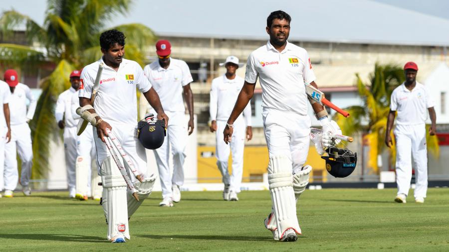 Kusal Perera and Dilruwan Perera troop off the field after steering Sri Lanka to victory