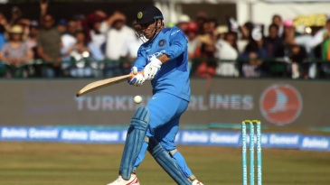 MS Dhoni forces the ball down on the leg side