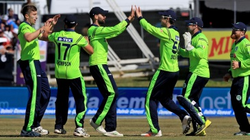 The Ireland players get together after the wicket of Virat Kohli