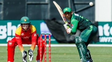 Sarfraz Ahmed steps down the track to meet the ball