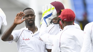 Kemar Roach celebrates a wicket with his team-mates