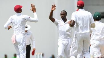Kemar Roach celebrates a wicket