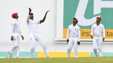 Jason Holder and his slip cordon react to a catch