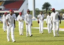 Shannon Gabriel (left) and Jason Holder (right) lead the West Indies players off the field after play, West Indies v Bangladesh, 1st Test, North Sound, 2nd day, July 5, 2018
