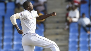 Jason Holder leaps to celebrate a wicket