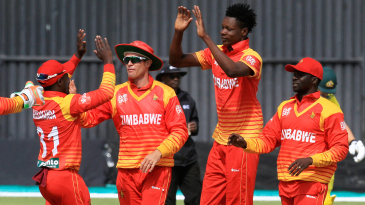Blessing Murzarabani celebrates a wicket with his team-mates
