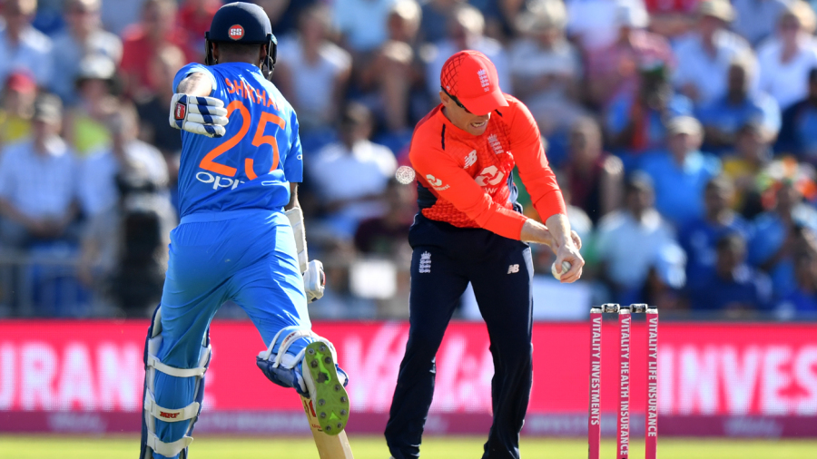 Shikhar Dhawan was caught short of his ground by Eoin Morgan