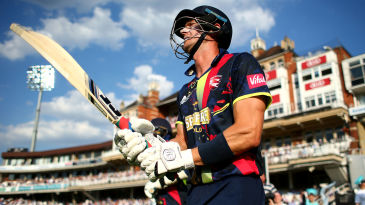 Joe Denly walks out in front of a full house at Kia Oval