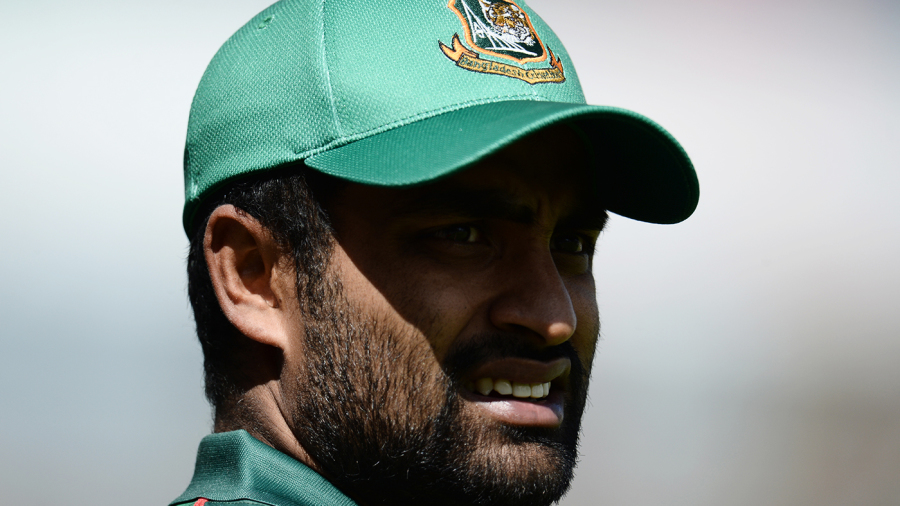 Tamim Iqbal looks on