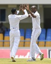 Keemo Paul celebrates with Miguel Cummins (right), West Indies v Bangladesh, 1st Test, North Sound, 2nd day, July 6, 2018