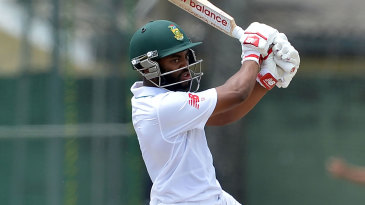 Temba Bavuma punches through the covers