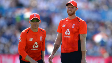 Eoin Morgan and Ben Stokes react in the field