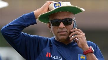 Sri Lanka coach Chandika Hathurusingha speaks on the phone during a training session