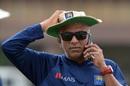 Sri Lanka coach Chandika Hathurusingha speaks on the phone during a training session, Sri Lanka v South Africa, 1st Test, Galle, July 11, 2018