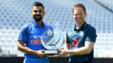 Virat Kohli and Eoin Morgan pose with the trophy