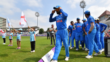 Virat Kohli leads the Indian team out onto the field