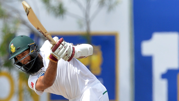 Hashim Amla holds his shape after bunting one away
