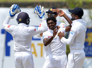 Lakshan Sandakan is mobbed by his team-mates upon picking a wicket, Sri Lanka v South Africa, 1st Test, Galle, 2nd day, July 13, 2018