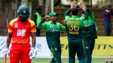 Usman Khan celebrates a wicket